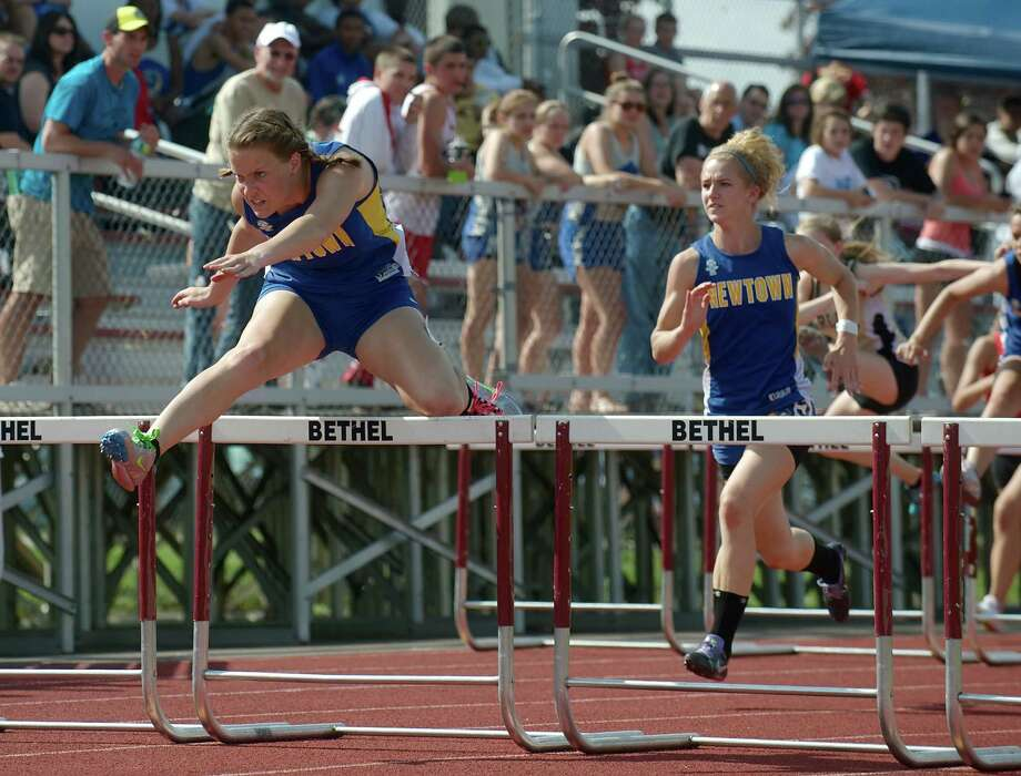 Melissa Buccino of Newtown High School running the 100 meter hurdles with Zoe Eggleston also from Newtown just behind her. during the South West Conference boys and girls track and field championships held at Bethel High School, Bethel, Conn. Monday May 20, 2013. Photo: H John Voorhees III