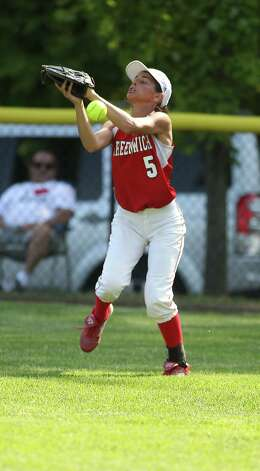 Greenwich softball player Jennifer Ambrogio can't come up with a fly ball hit her way during 1/4 final FCIAC softball action in Darien on Monday, May 20, 2013. The Blue Wave won the game, 4-1. Photo: J. Gregory Raymond / Stamford Advocate Freelance;  © J. Gregory Raymond
