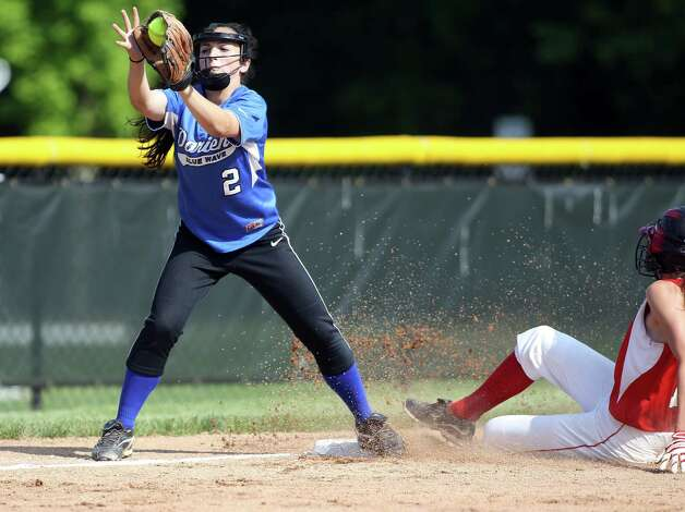 Darien High School third baseman Kelly Vodola takes a late throw to third to catch Greenwich baserunner Colleen Bennett on Monday, May 20, 2013. Photo: J. Gregory Raymond / Stamford Advocate Freelance;  © J. Gregory Raymond
