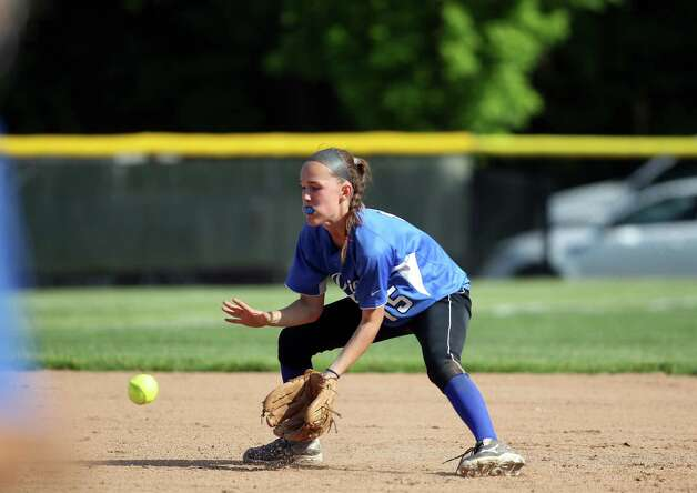Darien shortstop Avery Maley fields a ball hit to her during 1/4 final FCIAC softball action against Greenwich on Monday, May 20, 2013. Maley and her Darien teammates beat Greenwich, 4-1. Photo: J. Gregory Raymond / Stamford Advocate Freelance;  © J. Gregory Raymond