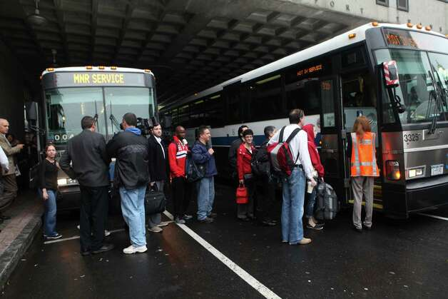 Commuters board a bus in Bridgeport to Stamford while train service is suspended on Monday, May 20, 2013. There was no train service from Bridgeport to South Norwalk because of a train collision on Friday. Photo: BK Angeletti, B.K. Angeletti / Connecticut Post freelance B.K. Angeletti