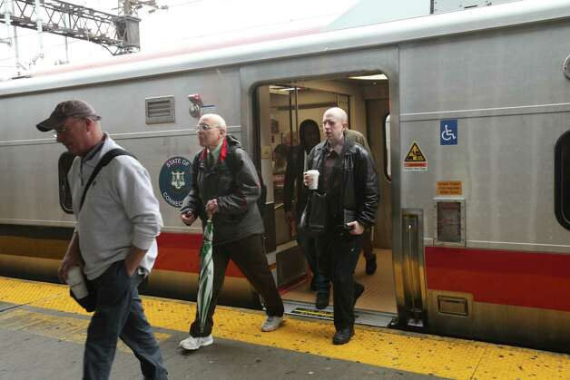 Commuters get off a southbound train in Bridgeport to board a bus heading for Stamford while train service is suspended on Monday, May 20, 2013. There was no train service from Bridgeport to South Norwalk because of a train collision on Friday. Photo: BK Angeletti, B.K. Angeletti / Connecticut Post freelance B.K. Angeletti
