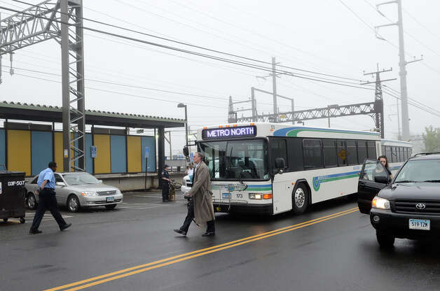 Commuters head to buses at the downtown Fairfield train station as they contend with lack of train service in Fairfield, CT on Monday morning, May 20, 2013. Photo: Shelley Cryan / Shelley Cryan for the CT Post/ freelance Shelley Cryan