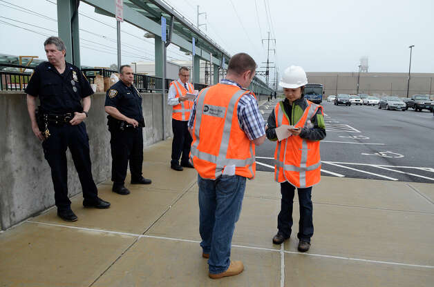 Metro North employees coordinate efforts at the Fairfield Metro train station, helping commuters contend with lack of train service on Monday morning, May 20, 2013 around 7am in Fairfield, CT. The station was uncharacteristically quiet at that time. Photo: Shelley Cryan / Shelley Cryan for the CT Post/ freelance Shelley Cryan