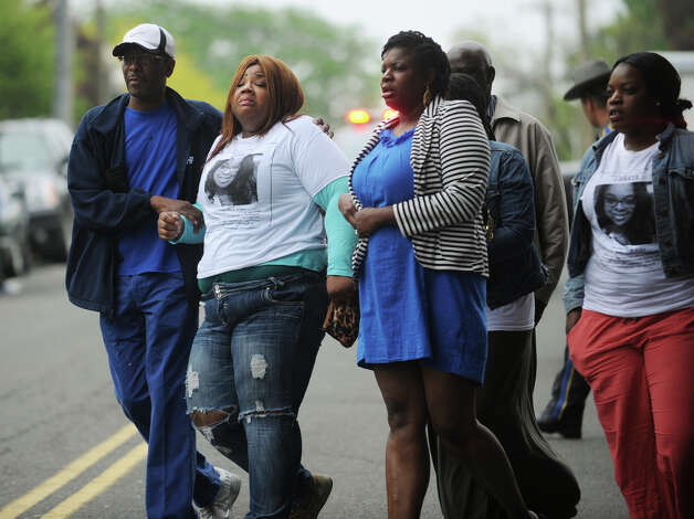 Family and friends of ECSU student Alyssiah Marie Wiley exit the arraignment on murder charges of Jermaine Richards at Superior Court in Bridgeport, Conn. on Monday, May 20, 2013. Photo: Brian A. Pounds / Connecticut Post