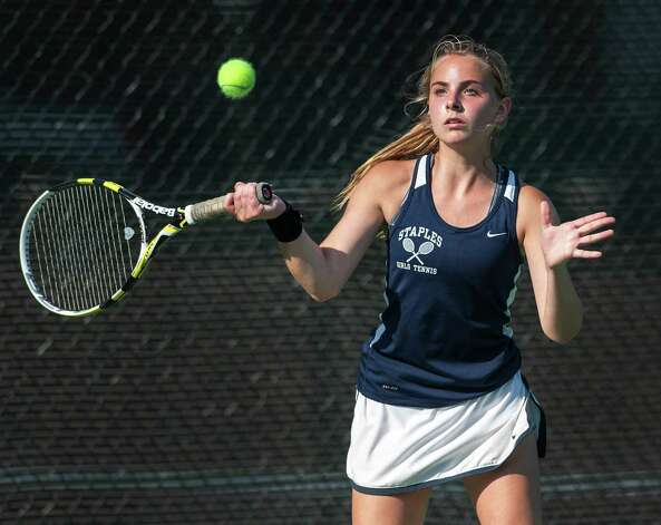 Staples high school's Alex Collins returns a shot during an FCIAC girls tennis semifinal doubles match against Fairfield Ludlowe high school's Colleen Fitzpatrick and Sarah Boyle played at Fairfield Ludlowe high school, Fairfield, CT on Monday May 20th, 2013. Alex's doubles partner was Callie Bartimer. Photo: Mark Conrad / Connecticut Post Freelance
