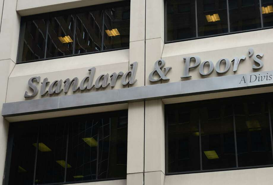 A sign for Standard & Poor's rating agency stands in front of the company headquarters in New York, September 18, 2012.  AFP PHOTO/Emmanuel Dunand        (Photo credit should read EMMANUEL DUNAND/AFP/GettyImages) Photo: EMMANUEL DUNAND, AFP/Getty Images / 2012 AFP