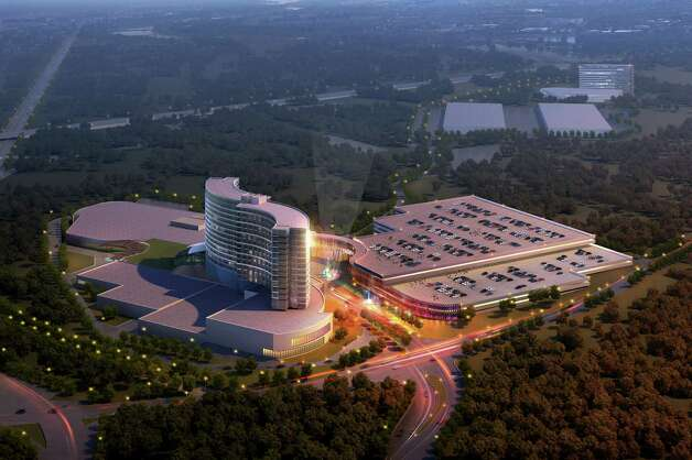 This architectural rendering, released Tuesday, May 14, 2013 by Regan Communications, shows a new design for a resort casino that the Mashpee Wampanoag tribe hopes to build in Taunton, Mass. if the tribe wins state and federal approvals for the project. The plans were unveiled at a meeting of the Taunton City Council on the eve of a key hearing before a legislative committee on a proposed casino compact the Mashpee Wampanoag tribe reached with Gov. Deval Patrick. (AP Photo/Regan Communications) Photo: Associated Press / AP/Regan Communications