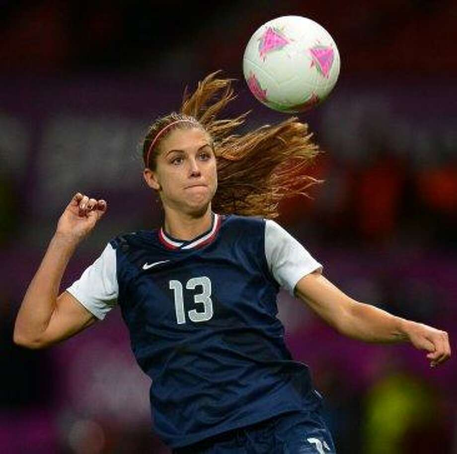 U.S. soccer star Alex Morgan, CalMorgan was the youngest player on the U.S. team at the 2011 World Cup and starred in the 2012 Olympics. She's currently playing in the Women's Women Cup in Canada. Photo: Andrew Yates, AFP/Getty Images