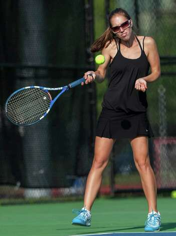 Fairfield Ludlowe high school's Erica Elmslie returns a shot during an FCIAC girls tennis semifinal doubles match against Staples high school's Avery Wallace and Xenia Bradley played at Fairfield Ludlowe high school, Fairfield, CT on Monday May 20th, 2013. Erica's doubles partner was Molly Boyd. Photo: Mark Conrad / Connecticut Post Freelance