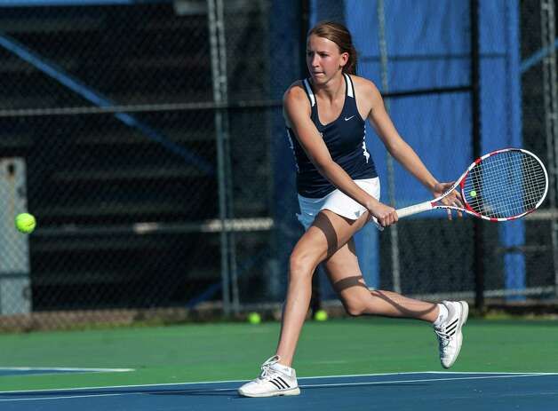 Staples high school's Avery Wallace returns a shot during an FCIAC girls tennis semifinal doubles match against Fairfield Ludlowe high school's Molly Boyd and Erica Elmslie played at Fairfield Ludlowe high school, Fairfield, CT on Monday May 20th, 2013. Avery's doubles partner was Xenia Bradley. Photo: Mark Conrad / Connecticut Post Freelance