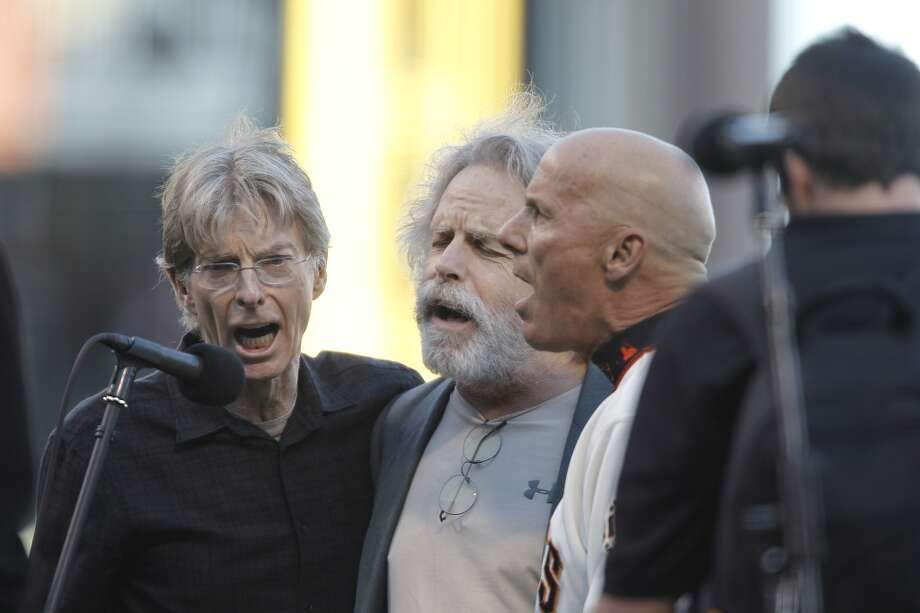 Grateful Dead band member Phil Lesh, CalLesh, left, sings with Bob Weir and the Giants' Tim Flannery before an NLCS game at AT&T Park in 2012. Photo: Michael Macor, The Chronicle