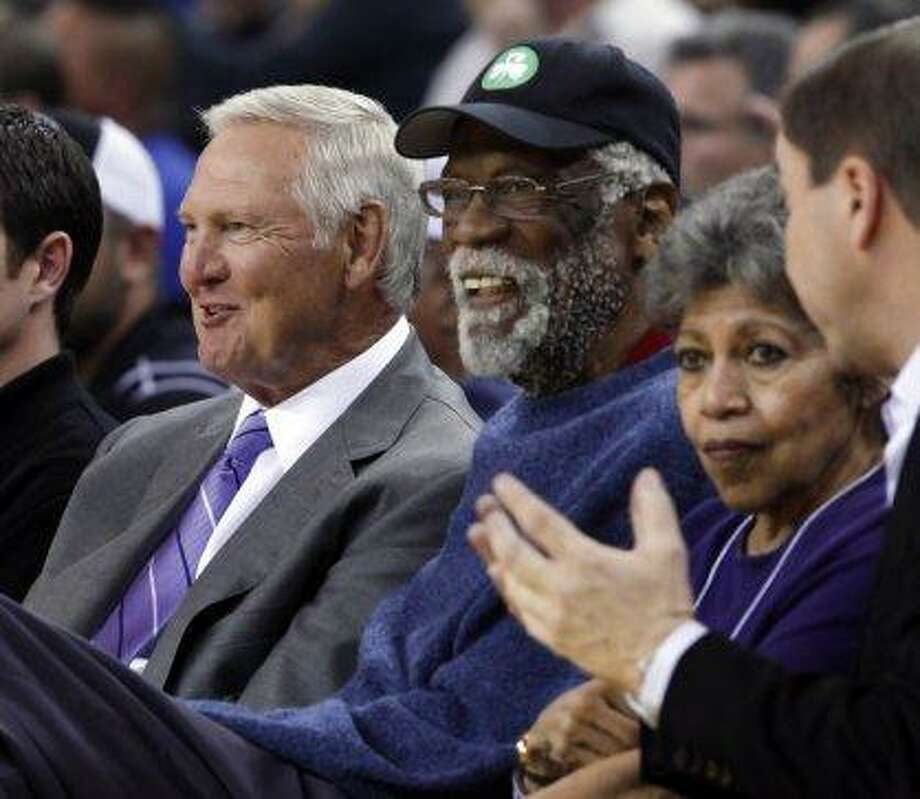 NBA great Bill Russell, USFRussell, center, sits next to Jerry West at a 2013 Warriors game. Photo: Carlos Avila Gonzalez, The Chronicle