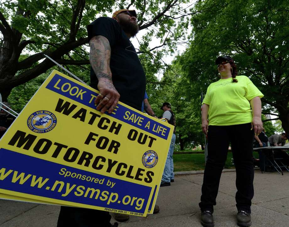 A small group of motorcyclists including David Birk, left and Caryn Grossman, came to town May 20, 2013, to show their feelings about various subject pertaining to the safety of motorcyclists on the streets and roads in New York.   (Skip Dickstein/Times Union) Photo: SKIP DICKSTEIN / 00022488A