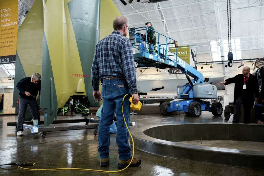 Workers spend an afternoon piecing together a massive Mittelwerk GmbH V-2 Nazi rocket Monday, May 20, 2013, at the Flying Heritage Collection in Everett. The rocket is one of 16 remaining in the world and the only one of its kind in Washington. This particular V-2 was restored from pieces recovered from an underground facility in Germany, and will remain on permanent display in Paul Allen's Flying Heritage Collection. Photo: JORDAN STEAD, SEATTLEPI.COM / SEATTLEPI.COM