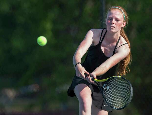 Fairfield Ludlowe high school's Colleen Fitzpatrick returns a shot during an FCIAC girls tennis semifinal doubles match against Staples high school's Alex Collins and Callie Bartimer played at Fairfield Ludlowe high school, Fairfield, CT on Monday May 20th, 2013. Colleen's doubles partner was Sarah Boyle. Photo: Mark Conrad / Connecticut Post Freelance