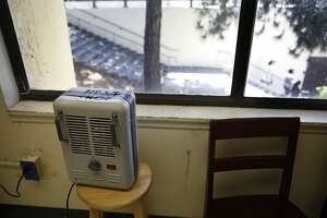 A portable space heater sits on a bench inside a classroom at Fremont High School on Friday, May 17, 2013 in Oakland, Calif.  Fremont High School is scheduled to be a zero net energy school but projects have not yet started due to lack of receiving bond money.