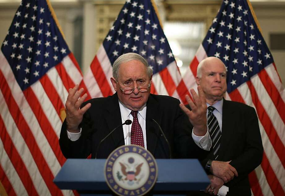 Sens. Carl Levin, D-Mich. (center), and John McCain, R-Ariz., try to crack down on what they call abuses of tax havens. Photo: Mark Wilson, Getty Images