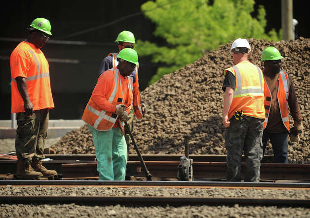 Work continues on the tracks to repair the area of Friday's train derailment and collision off State Street extension in Bridgeport, Conn. on Monday, May 20, 2013. Photo: Brian A. Pounds / Connecticut Post