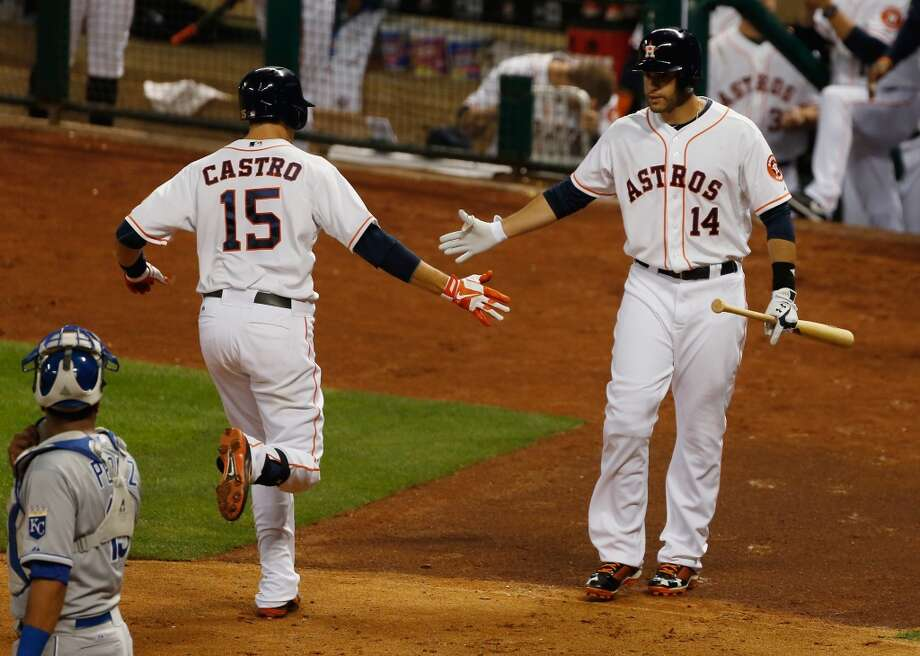 Jason Castro is greeted by J.D. Martinez  after hitting his home run.