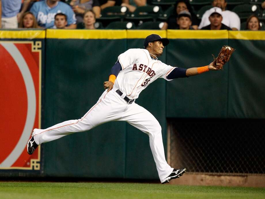 Astros right fielder Jimmy Paredes stretches to make a catch on a line drive by Royals center fielder Lorenzo Cain.