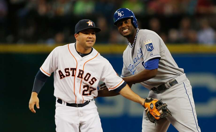 Jose Altuve of the Astros has a luagh at second base with Lorenzo Cain.