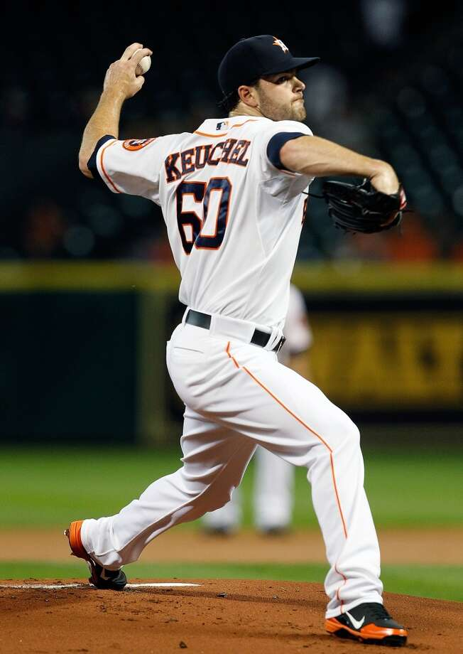 Astros pitcher Dallas Keuchel pitches in the first inning.