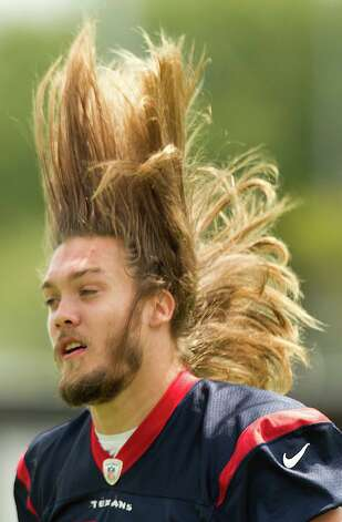 Houston Texans linebacker Bryan Braman flips his hair as he walks across the practice field before Texans' Organized Team Activities at the Methodist Training Center Monday, May 20, 2013, in Houston. Photo: Brett Coomer, Houston Chronicle / © 2013 Houston Chronicle