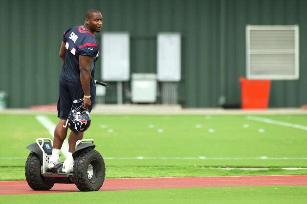 Houston Texans defense end Antonio Smith rides a Segway across the practice field before Texans' Organized Team Activities at the Methodist Training Center Monday, May 20, 2013, in Houston. Photo: Brett Coomer, Houston Chronicle / © 2013 Houston Chronicle