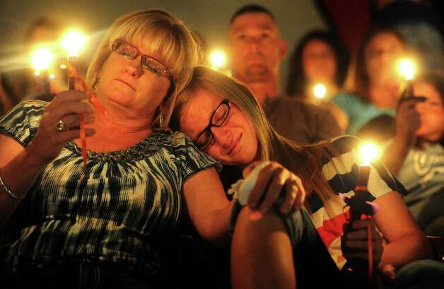 Tracy Hopper comforts her daughter, Maci Hopper, 13, as they remember Hailey Dunn during a memorial service Sunday, May 19, 2013 at Colorado Middle School in Colorado City, Texas. Through prayers, songs, pictures and shared memories, Hailey's friends, family and schoolteachers gathered Sunday at Colorado Middle School — where she was a student — to remember a young girl whose remains were found in March. Photo: Joy Lewis, Associated Press / Abilene Reporter-News