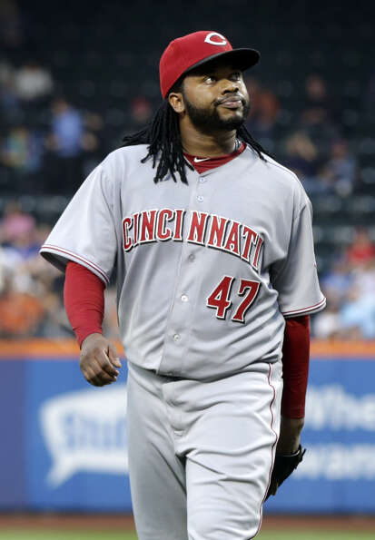 Cincinnati Reds starting pitcher Johnny Cueto reacts at the end of the first inning of the baseball