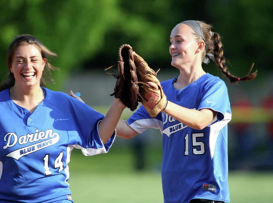 Darien High School softball players Julia Domiziano and Avery Maley exchange high fives following the Blue Wave's FCIAC win over Greenwich in the quarterfinals at Darien High School on Monday, May 20, 2013. Photo: J. Gregory Raymond / Stamford Advocate Freelance;  © J. Gregory Raymond