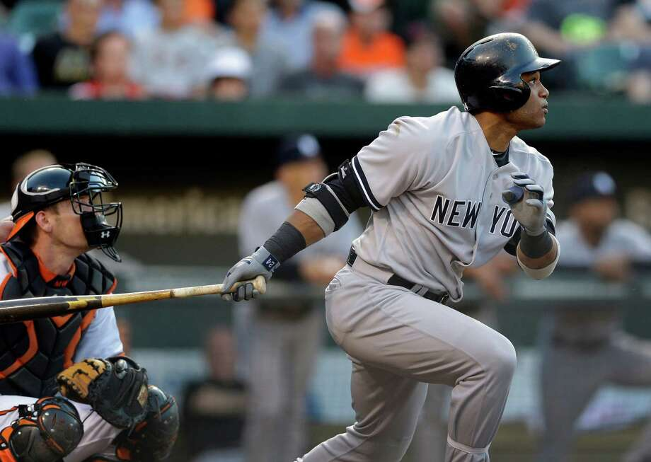 New York Yankees' Robinson Cano watches his solo home run in the first inning of a baseball game against the Baltimore Orioles in Baltimore, Monday, May 20, 2013. (AP Photo/Patrick Semansky) Photo: Patrick Semansky