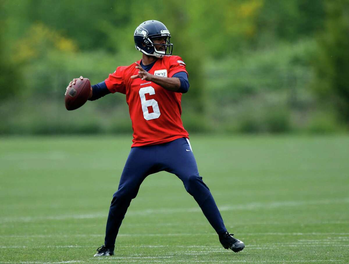 Seattle Seahawks backup quarterback Josh Portis passes Monday, May 20, 2013, during an NFL football organized team activity workout in Renton, Wash. Portis was arrested on investigation of driving under the influence on May 5 and faces a court arraignment next week. (AP Photo/Ted S. Warren)