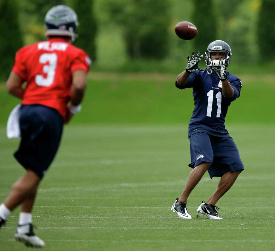 Seattle Seahawks new wide receiver Percy Harvin (11) catches a pass from quarterback Russell Wilson (3), Monday, May 20, 2013, during an NFL football organized team activity workout in Renton, Wash. (AP Photo/Ted S. Warren) Photo: Associated Press