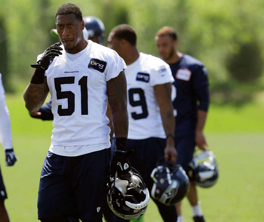 Seattle Seahawks' Bruce Irvin (51) leaves the field Monday, May 20, 2013, after during an NFL football organized team activity workout in Renton, Wash. The team announced last Friday that Irvin had been suspended for the first four games of the upcoming 2013 season after testing positive for performance enhancing substances. (AP Photo/Ted S. Warren) Photo: Associated Press