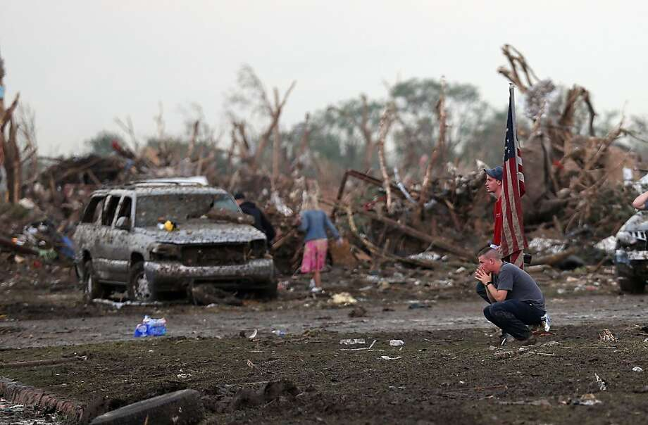 People react in front of the Plaza Towers Elementary school in Moore following a deadly tornado, Monday, May 20, 2013.  (AP Photo/ The Oklahoman, Sarah Phipps) Photo: Sarah Phipps, Associated Press