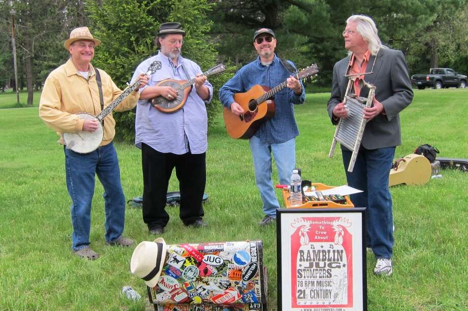 The Ramblin Jug Stompers gladly would have paid more than a hobo nickel for something other than the large shrubbery for coverage.