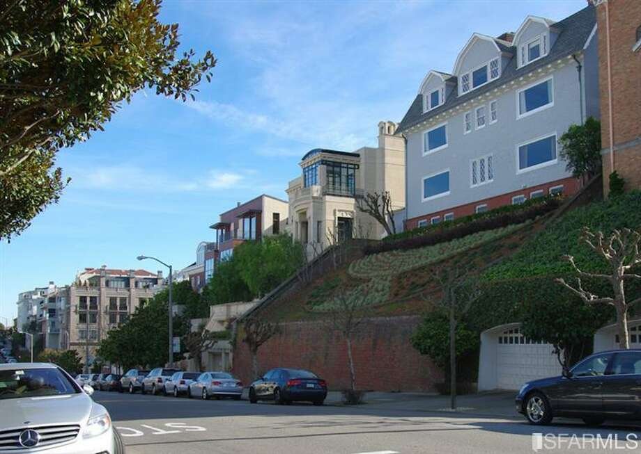Seen from the street is this 11,500 square foot mansion on Pacific in SF. Photo via MLS/Redfin.