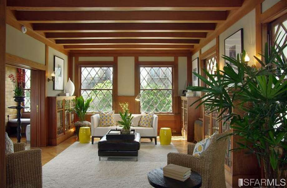Grand living room. Photo via MLS/Redfin.