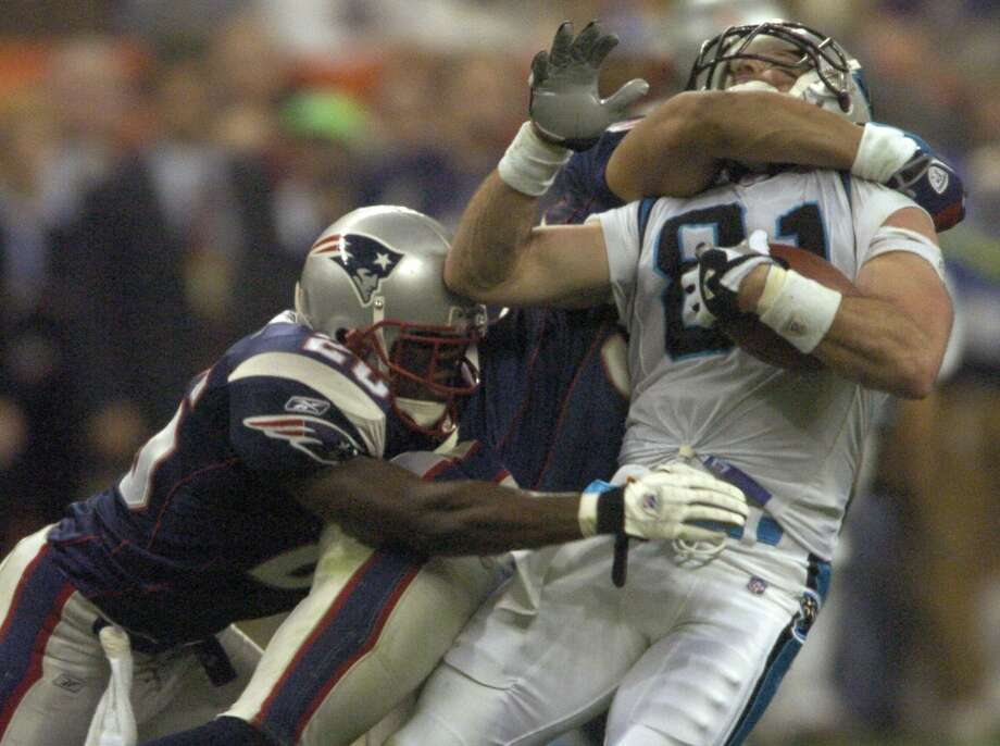 Carolina's Ricky Proehl is clotheslined by Rodney Harrison. Photo: Karl Stolleis, HOUSTON CHRONICLE
