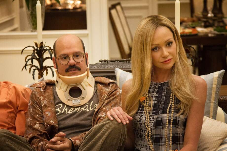 "David Cross (L) and Portia de Rossi (R) in a scene from Netflix's ""Arrested Development."""