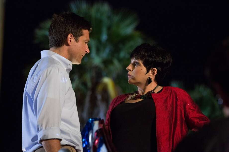 "Jason Bateman (L) and guest star Liza Minnelli (R) in a scene from Netflix's ""Arrested Development."""