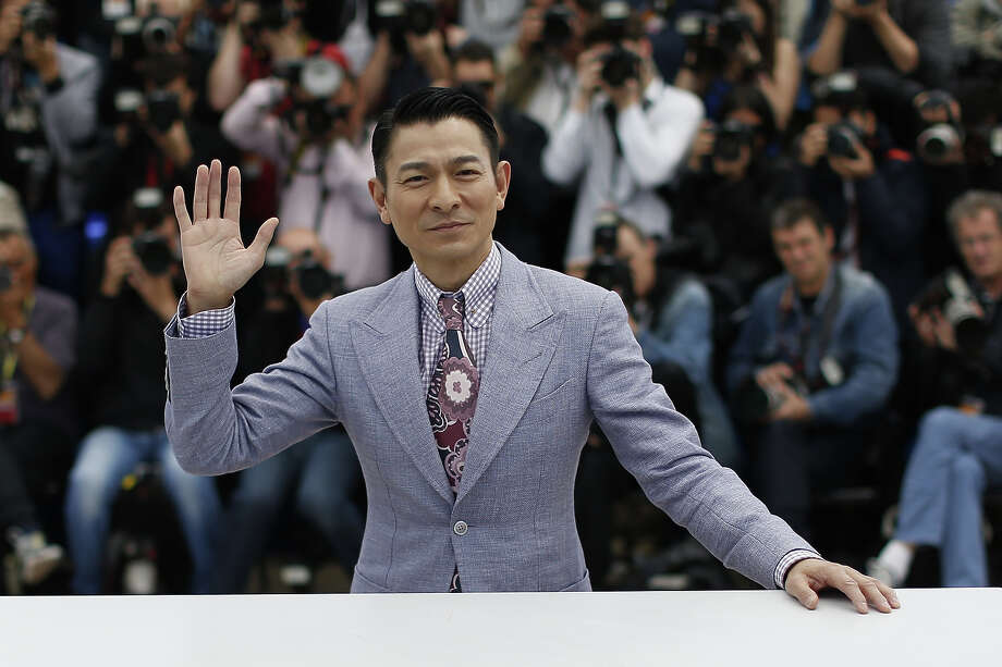 "Chinese actor Andy Lau waves on May 20, 2013 while posing during a photocall for the film ""Blind Detective"" presented Out of Competition at the 66th edition of the Cannes Film Festival in Cannes. Cannes, one of the world's top film festivals, opened on May 15 and will climax on May 26 with awards selected by a jury headed this year by Hollywood legend Steven Spielberg. Photo: VALERY HACHE, AFP/Getty Images / 2013 AFP"