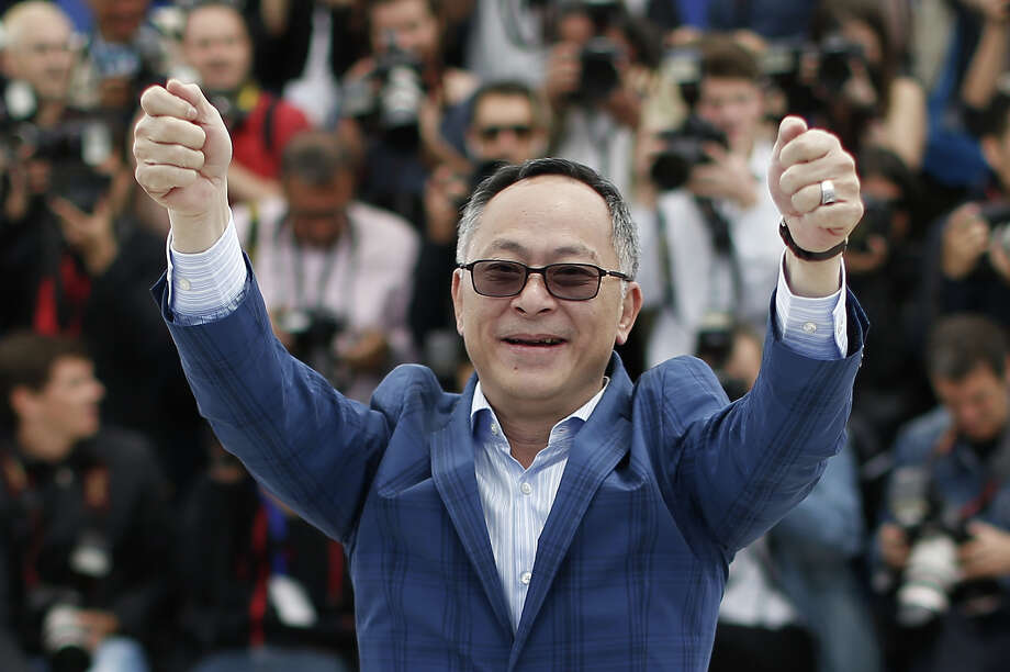 "Chinese director Johnnie To gestures on May 20, 2013 while posing during a photocall for the film ""Blind Detective"" presented Out of Competition at the 66th edition of the Cannes Film Festival in Cannes. Cannes, one of the world's top film festivals, opened on May 15 and will climax on May 26 with awards selected by a jury headed this year by Hollywood legend Steven Spielberg. Photo: VALERY HACHE, AFP/Getty Images / 2013 AFP"