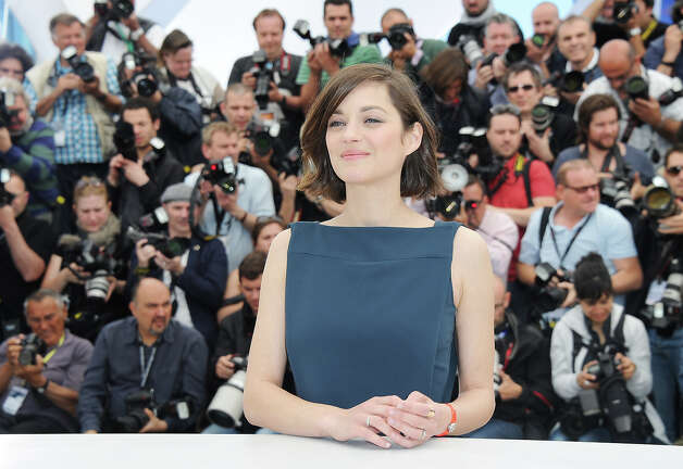 Actress Marion Cotillard attends the photocall for 'Blood Ties' at The 66th Annual Cannes Film Festival on May 20, 2013 in Cannes, France. Photo: Pascal Le Segretain, Getty Images / 2013 Getty Images