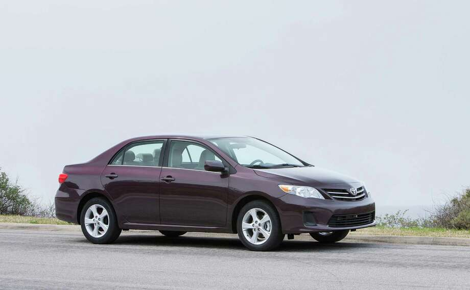 2013 Toyota Corolla LE Price: $18,975 Fuel cost: $9,250 Total: $28,225Source: Cars.com Photo: File