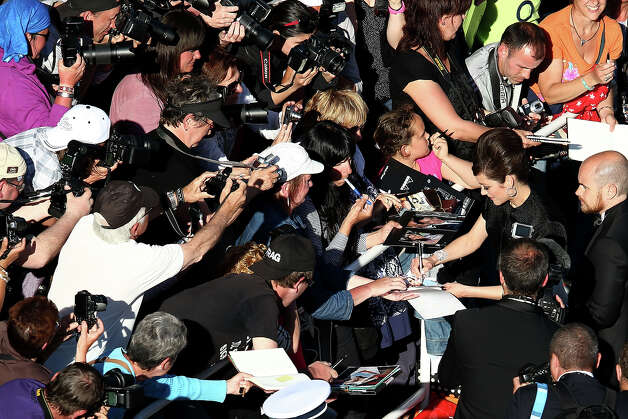 "Marion Cotillard signs autographs at the ""Blood Ties"" Premiere during the 66th Annual Cannes Film Festival at Grand Theatre Lumiere on May 20, 2013 in Cannes, France. Photo: Andreas Rentz, Getty Images / 2013 Getty Images"