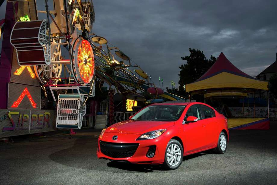 2013 Mazda3 iSport Price: $20,020 Fuel cost: $9,000 Total: $29,020Source: Cars.com Photo: Guy Spangenberg, File / ©Guy Spangenberg, 2012