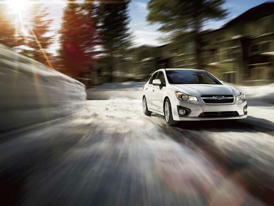 2013 Subaru Impreza 2.0iPrice: $21,065Fuel cost: $9,000Total: $30,065Source:Cars.com Photo: File